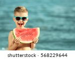 Cute Boy Eating Watermelon On...