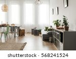 bright room with dining area... | Shutterstock . vector #568241524