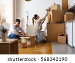 young couple unpacking... | Shutterstock . vector #568242190