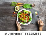 hand holding salad bowl with... | Shutterstock . vector #568252558