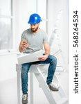 handsome repairman or builder... | Shutterstock . vector #568264534