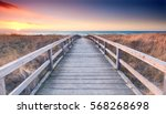 wooden path at baltic sea over... | Shutterstock . vector #568268698