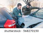 two men writing a car insurance ... | Shutterstock . vector #568270150
