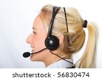 A young, attractive businesswoman wearing headphones - stock photo