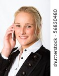 A young businesswoman talking on a mobile phone - stock photo