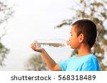 little boy drinking pure water...   Shutterstock . vector #568318489