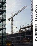 crane on a construction site | Shutterstock . vector #568319998