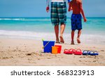 father and son go swim at beach | Shutterstock . vector #568323913