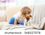 Cute Little Boy With Puppy On...