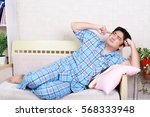 tired and stressed asian man | Shutterstock . vector #568333948