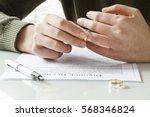 woman taking off wedding ring | Shutterstock . vector #568346824