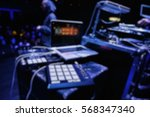 Small photo of Blurred background of pad controller for dj on stage.Professional beat maker equipment.Play beats,push pad buttons on live performance.Music festival blurry back ground