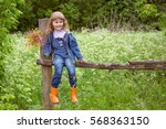 girl sitting on an old wooden... | Shutterstock . vector #568363150
