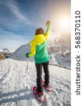 snowshoeing hiker woman walking ... | Shutterstock . vector #568370110