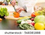 cook preparing vegetable salad... | Shutterstock . vector #568381888