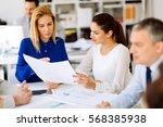 business people working in... | Shutterstock . vector #568385938