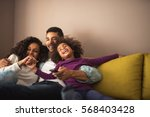 mother  father and daughter... | Shutterstock . vector #568403428