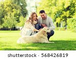 Stock photo family pet animal and people concept happy couple with labrador retriever dog walking in city 568426819