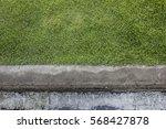 green grass and cement floor | Shutterstock . vector #568427878