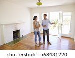 male realtor showing female... | Shutterstock . vector #568431220