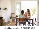 two female friends enjoying... | Shutterstock . vector #568431520