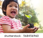asian kid hand holding young... | Shutterstock . vector #568456960