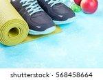 yoga mat  sport shoes  apples ... | Shutterstock . vector #568458664