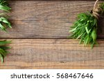 bunch of fresh tarragon on a... | Shutterstock . vector #568467646