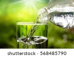 drink water pouring in to glass ... | Shutterstock . vector #568485790