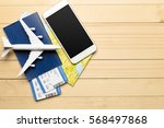 travel objects on wooden... | Shutterstock . vector #568497868