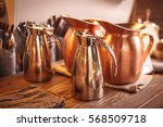 copper jars on the wooden table | Shutterstock . vector #568509718