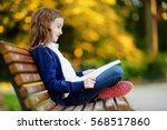 adorable little schoolgirl in a ... | Shutterstock . vector #568517860