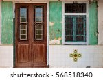locked wooden front door and... | Shutterstock . vector #568518340