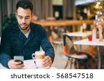 young man sitting at cafe... | Shutterstock . vector #568547518