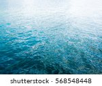 blue ripple water wave on sand... | Shutterstock . vector #568548448