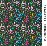 Stock vector cute seamless pattern in small flower small pink yellow and blue flowers dark green background 568549558