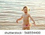 little girl splashing in the...   Shutterstock . vector #568554400