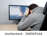 worried man watching  on tv ... | Shutterstock . vector #568569166