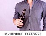 man wearing shirt holding a... | Shutterstock . vector #568570774