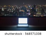 computer on rootop at night... | Shutterstock . vector #568571338