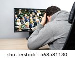 troubled man watching  on tv ... | Shutterstock . vector #568581130