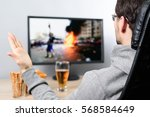 agitated man watching  on tv ... | Shutterstock . vector #568584649