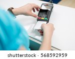woman pays with ec card at the... | Shutterstock . vector #568592959