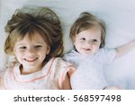 two little sisters together.... | Shutterstock . vector #568597498
