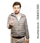 confident man doing a handshake ... | Shutterstock . vector #568601380