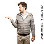 happy man doing a show gesture | Shutterstock . vector #568601464