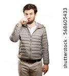 worried man doing a disgust... | Shutterstock . vector #568605433