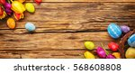 easter eggs with tulips on... | Shutterstock . vector #568608808