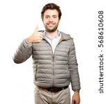happy man doing an okay gesture | Shutterstock . vector #568610608