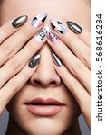 Small photo of beautiful female hands cover her face.manicure. Close-up fashion Portrait.Model Girl Face. Make-up and nails